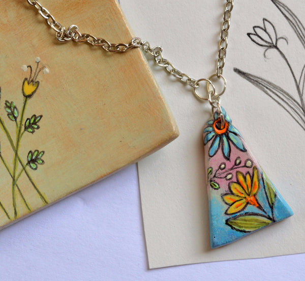 Necklace With A Pendant Illustrated With A Fun Floral Design