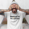 Man wearing Impeach the orange shirt