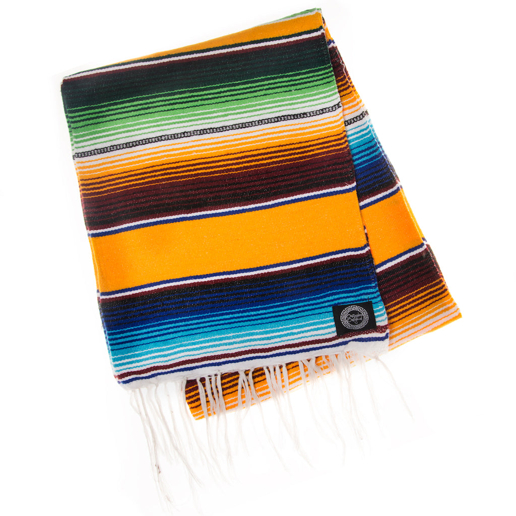 yellow and blue Mexican blanket