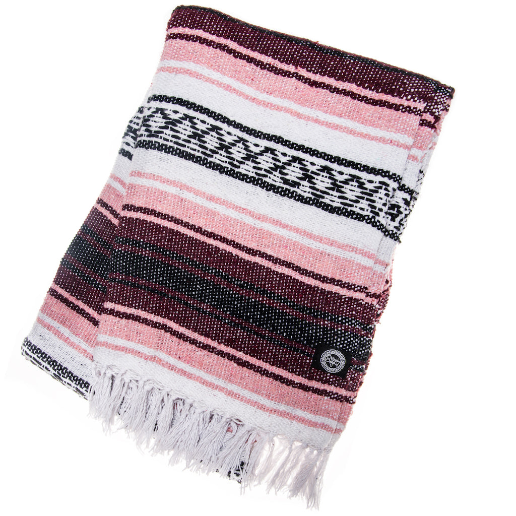 pink and brown mexican blanket