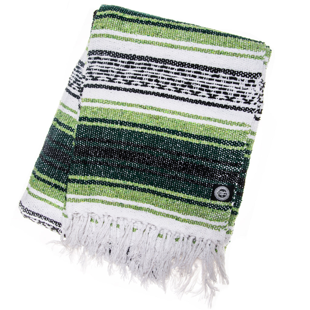 green and white Mexican blanket