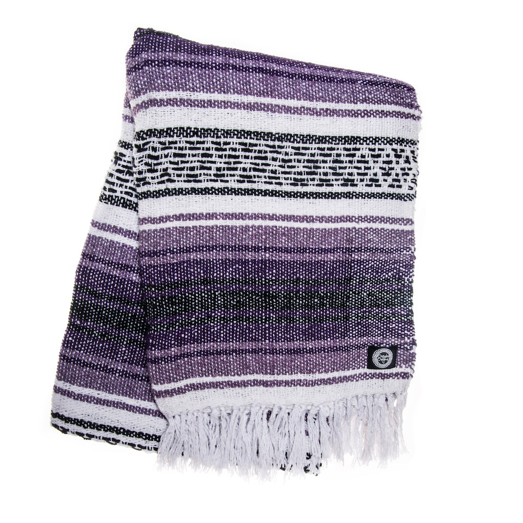purple white and black Mexican falsa blanket