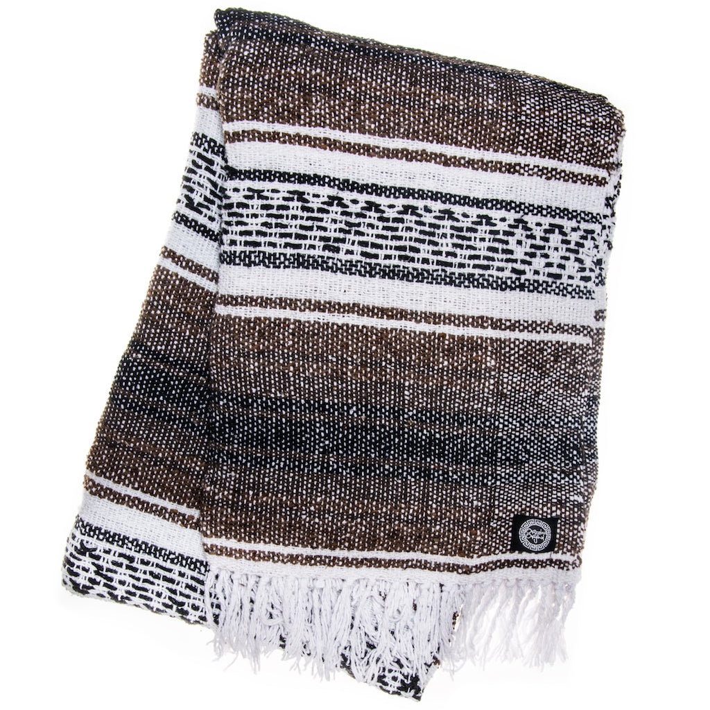 brown white and black Mexican blanket