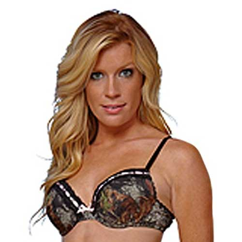50fe2c2c23935 Padded underwire bra in Mossy Oak camo print features black accent straps  and closure. It is trimmed in black scalloped lace with a pink satin ribbon  and ...