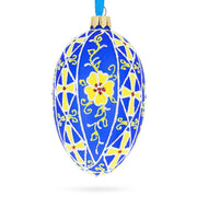 Yellow Flowers On Blue Glass Egg Ornament
