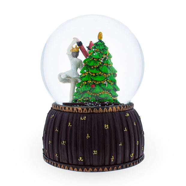 Nutcracker and Ballerina Dancing around Christmas Tree Musical Snow Globe