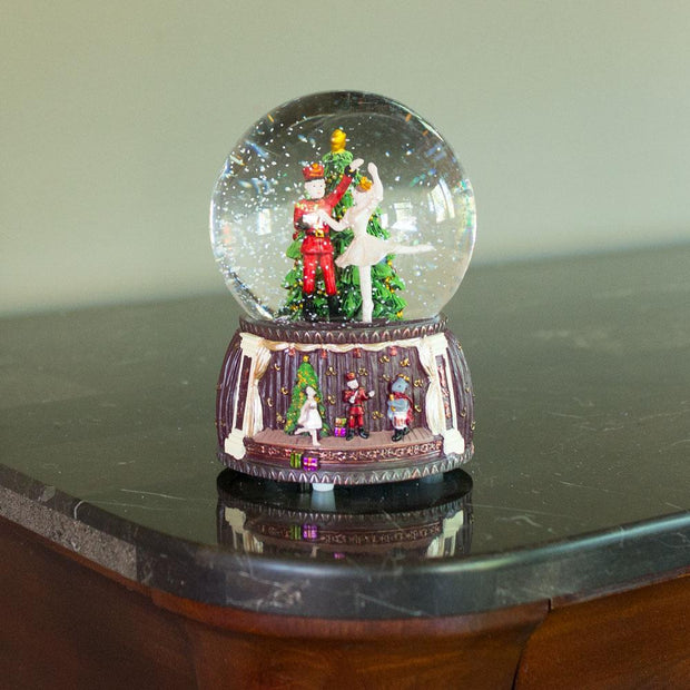 Spinning Nutcracker and Ballerina Dancing around Christmas Tree Musical Water Snow Globe Figurine
