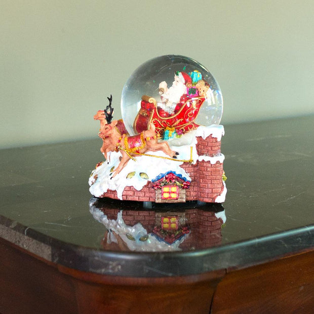 Santa Delivers Christmas Gifts Musical Snow Globe