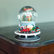 Santa Flying over Winter Village & Rotating Train Musical Water Snow Globe
