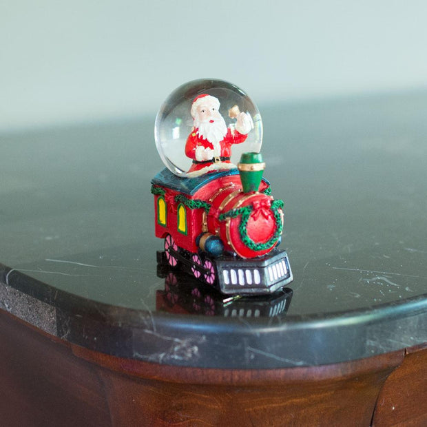 Santa Ringing a Bell on a Christmas Train Snow Globe
