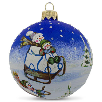 Snowman Sledding between Trees Glass Ball Christmas Ornament 3.25 Inches by BestPysanky