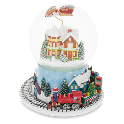 Santa Flying over Winter Village & Rotating Train Musical Snow Globe by BestPysanky