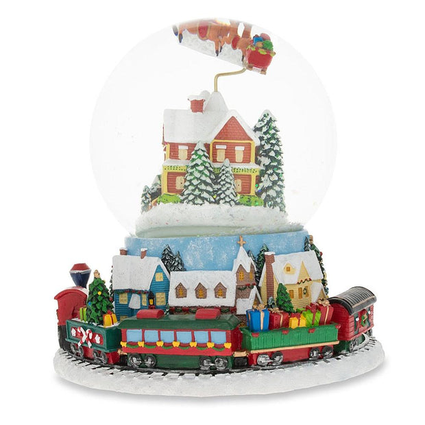 Buy Online Gift Shop Santa Flying over Winter Village & Rotating Train Musical Snow Globe