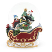 Penguins Riding on the Sleigh Snow Globe by BestPysanky