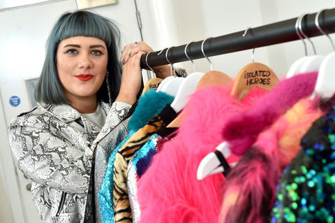 Fashion designer Samantha Paton stands next to the new season rail of Isolated Heroes garments