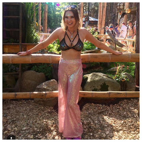 Insta famous lifestyle youtuber Lynsey Hughes aka Livin Like Lyndsey wears Isolated Heroes barbie sequin flares to Electric forrest festival