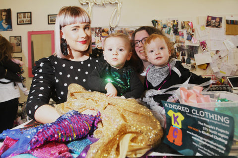 Designer Samantha Patom sits with baby son River, helping new mums on workshop