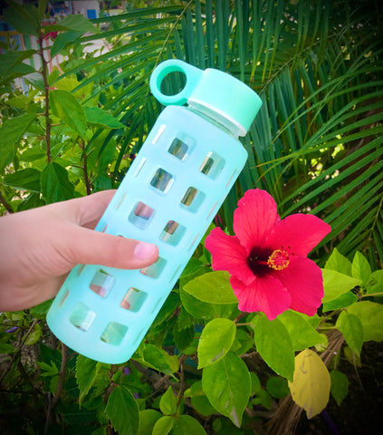 Purifyou bottle with flower