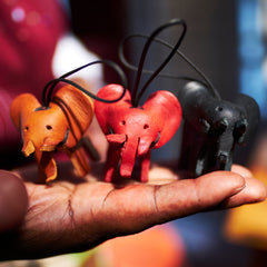 Afrographic elephant key rings in hand of crafter