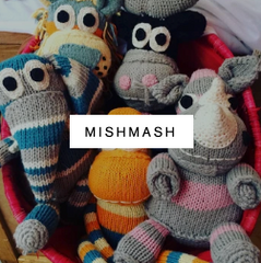 image of a basket of little ndaba toys snuggled together with mishmash logo super imposed on top