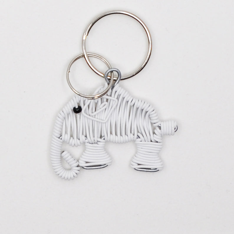 white wire art elephant keychain. handmade in South Africa. percentage of sale donated back to conservation in Africa