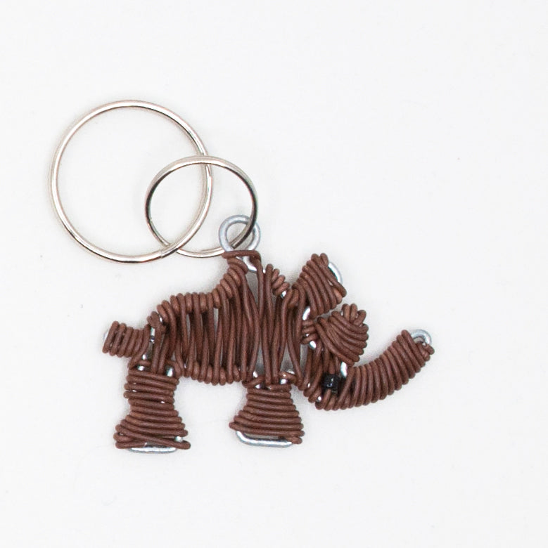 brown wire art rhino keychain. handmade in South Africa. percentage of sale donated back to conservation in Africa