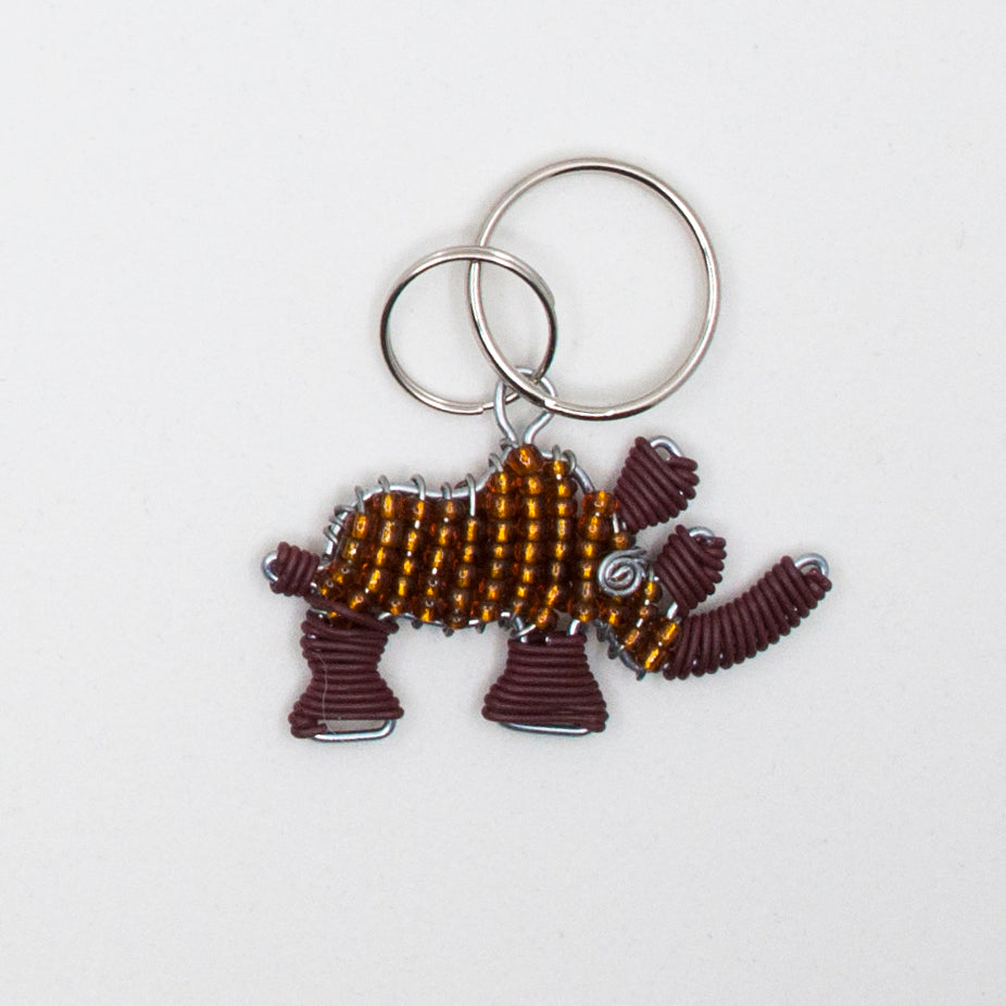 brown wire and bead  rhino keychain. handmade in South Africa. percentage of sale donated back to conservation in Africa