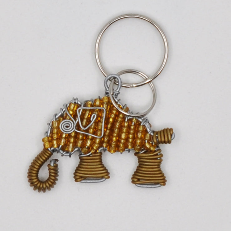 light brown/copper wire and bead elephant keychain. handmade in South Africa. percentage of sale donated back to conservation in Africa