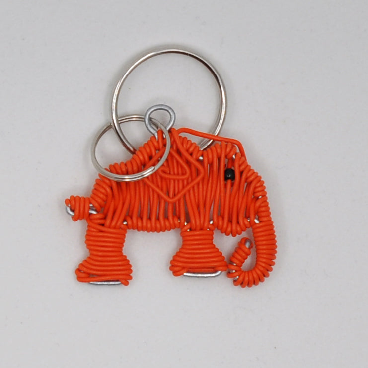 orange wire art elephant keychain. handmade in South Africa. percentage of sale donated back to conservation in Africa