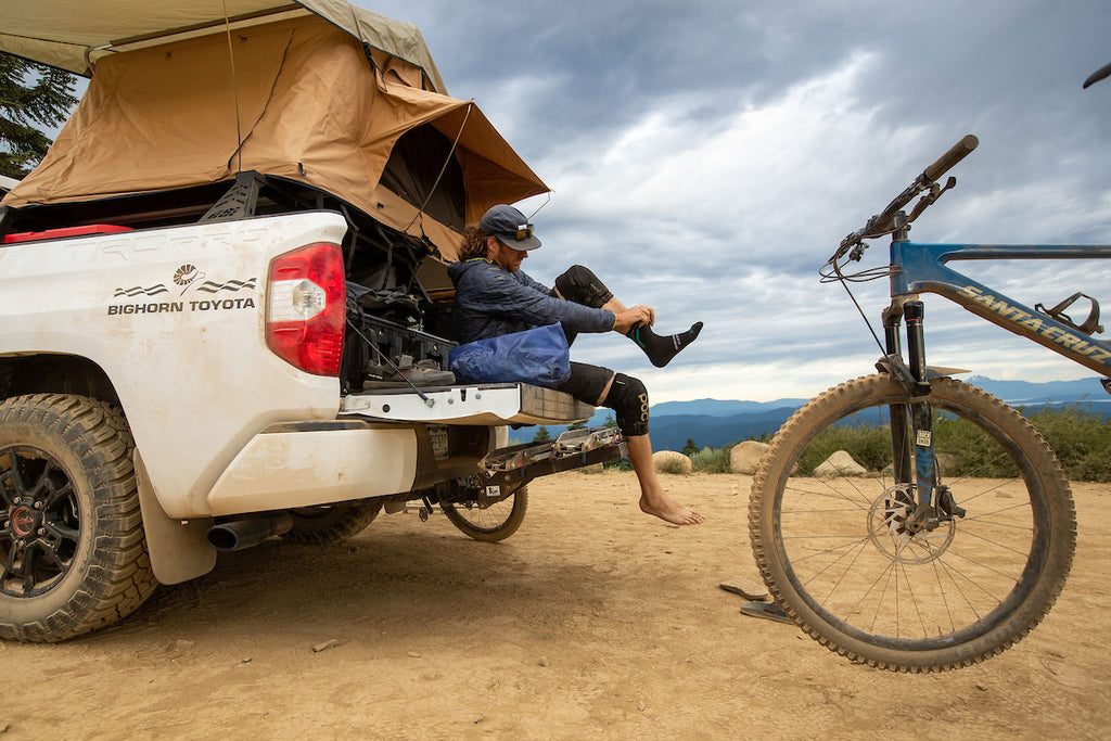Truck toolbox storage for bike and camping gear