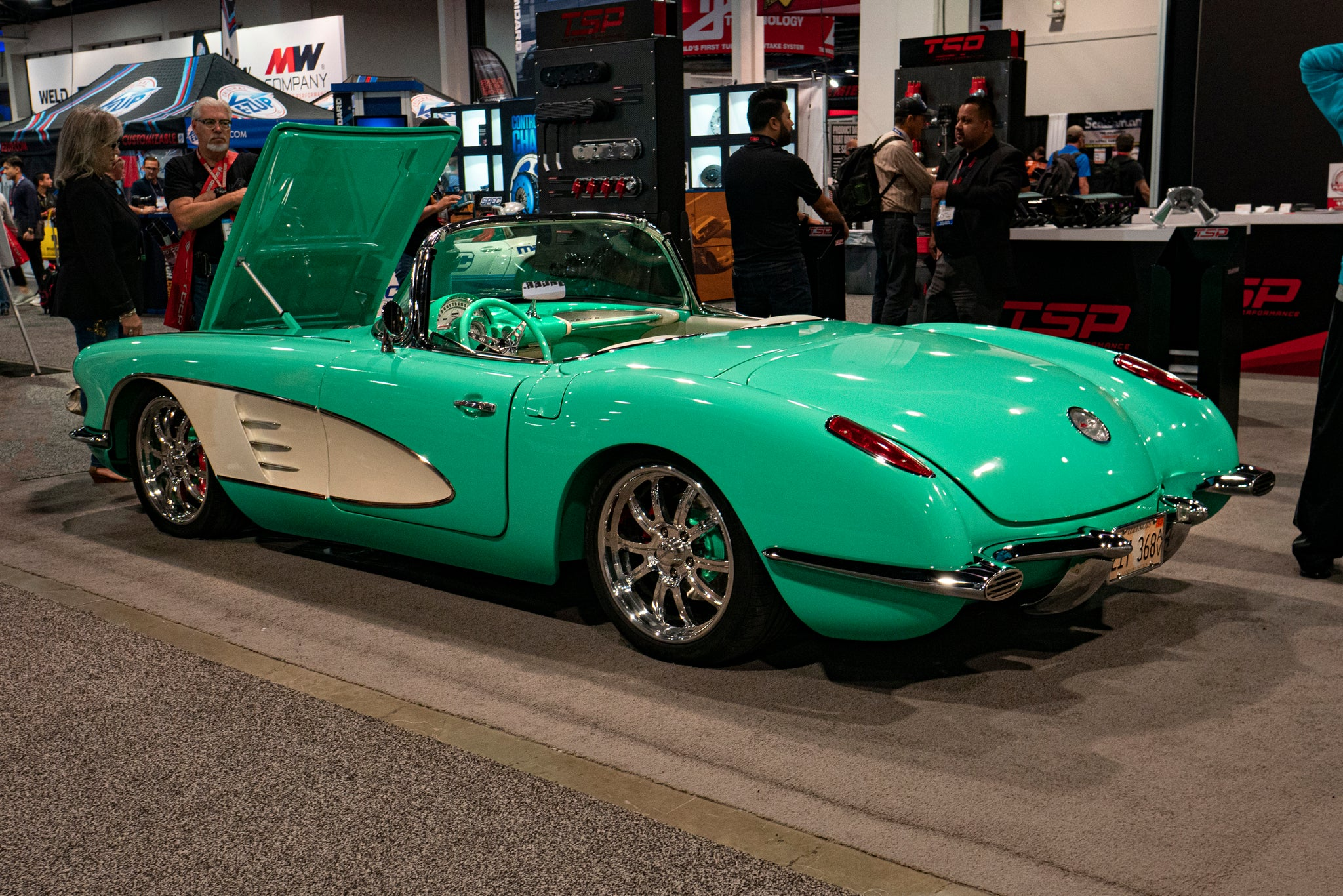 Old green and white car at Sema