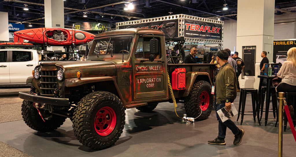 Wider angle of the old truck at the DECKED Sema booth