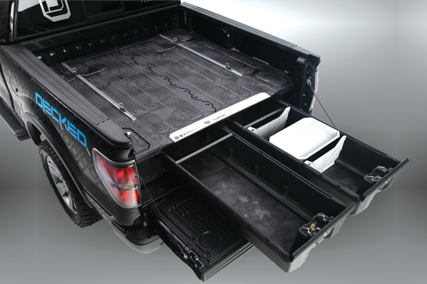 The DECKED truck bed storage system is designed to maximize the use of space with divided drawers and a deck that can support a 2000-lb. payload. Image courtesy of DECKED.