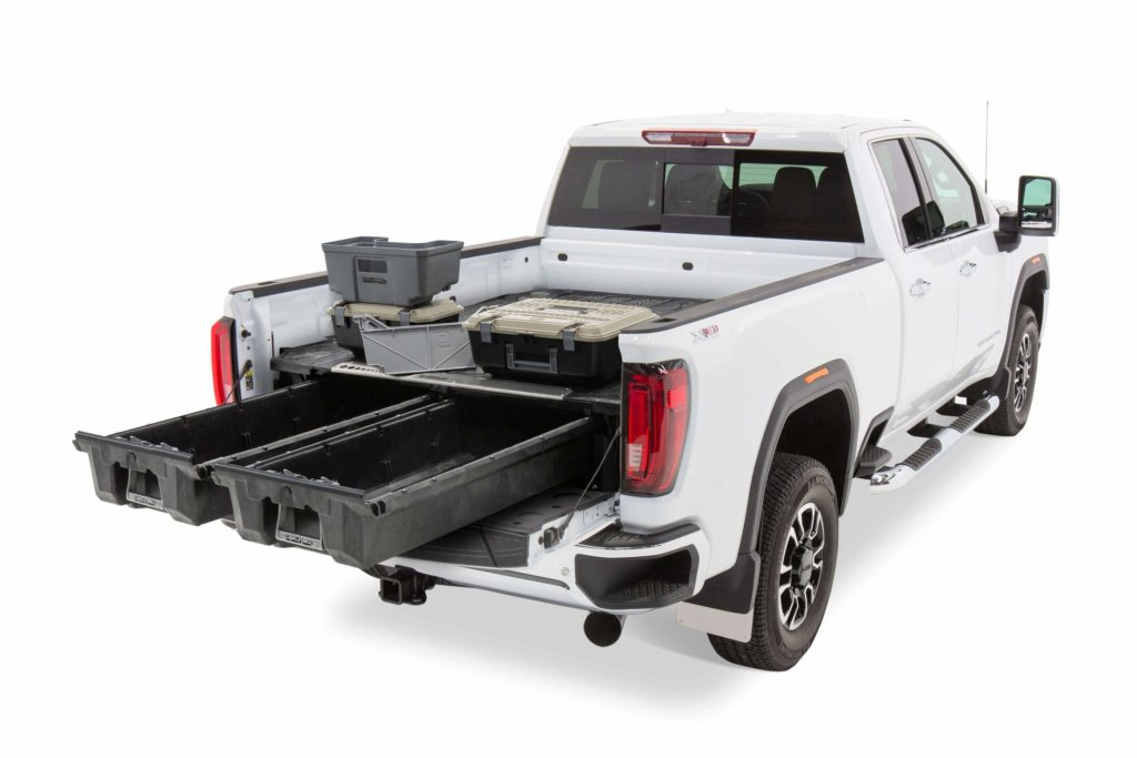 The back of a GMC truck with DECKED shelves.