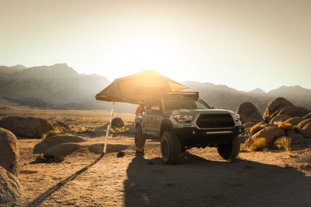 Toyota Tacoma with camping gear.