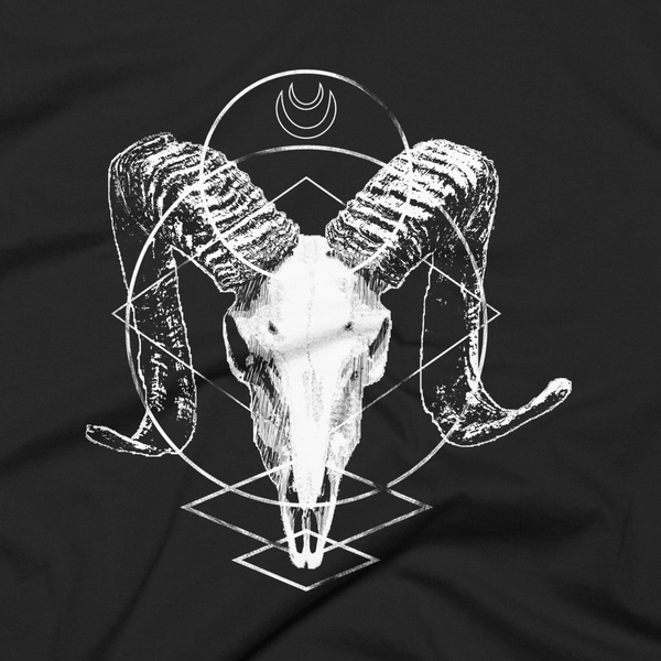 close up of an alternative ram skull design against a black cotton background