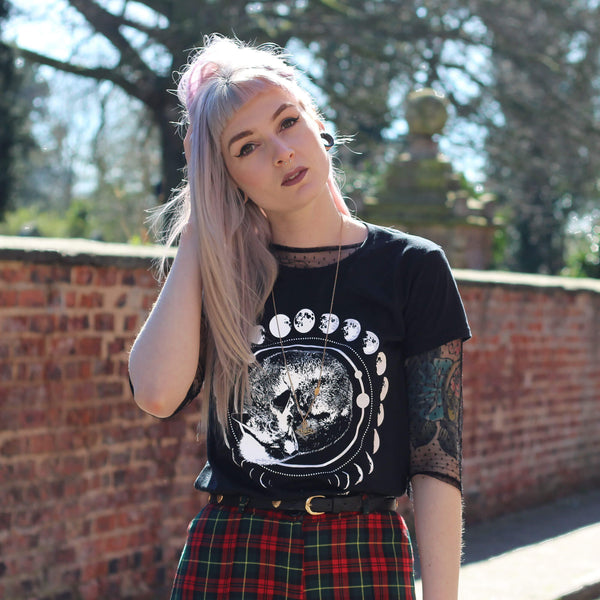 Jessica from I AM FOXXTAILZ wearing a black moon and fox t-shirt.