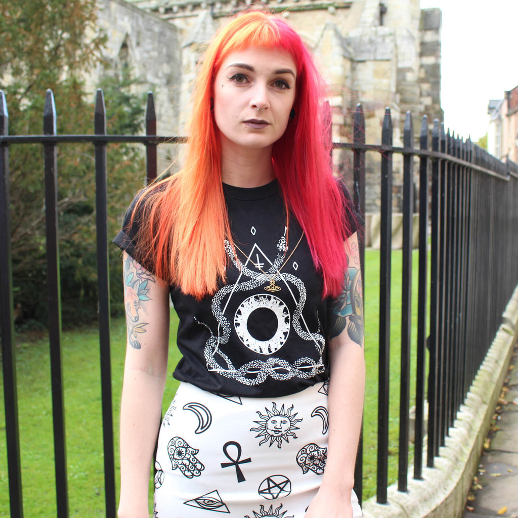 Alternative girl with red and orange hair wearing a black snake t-shirt.