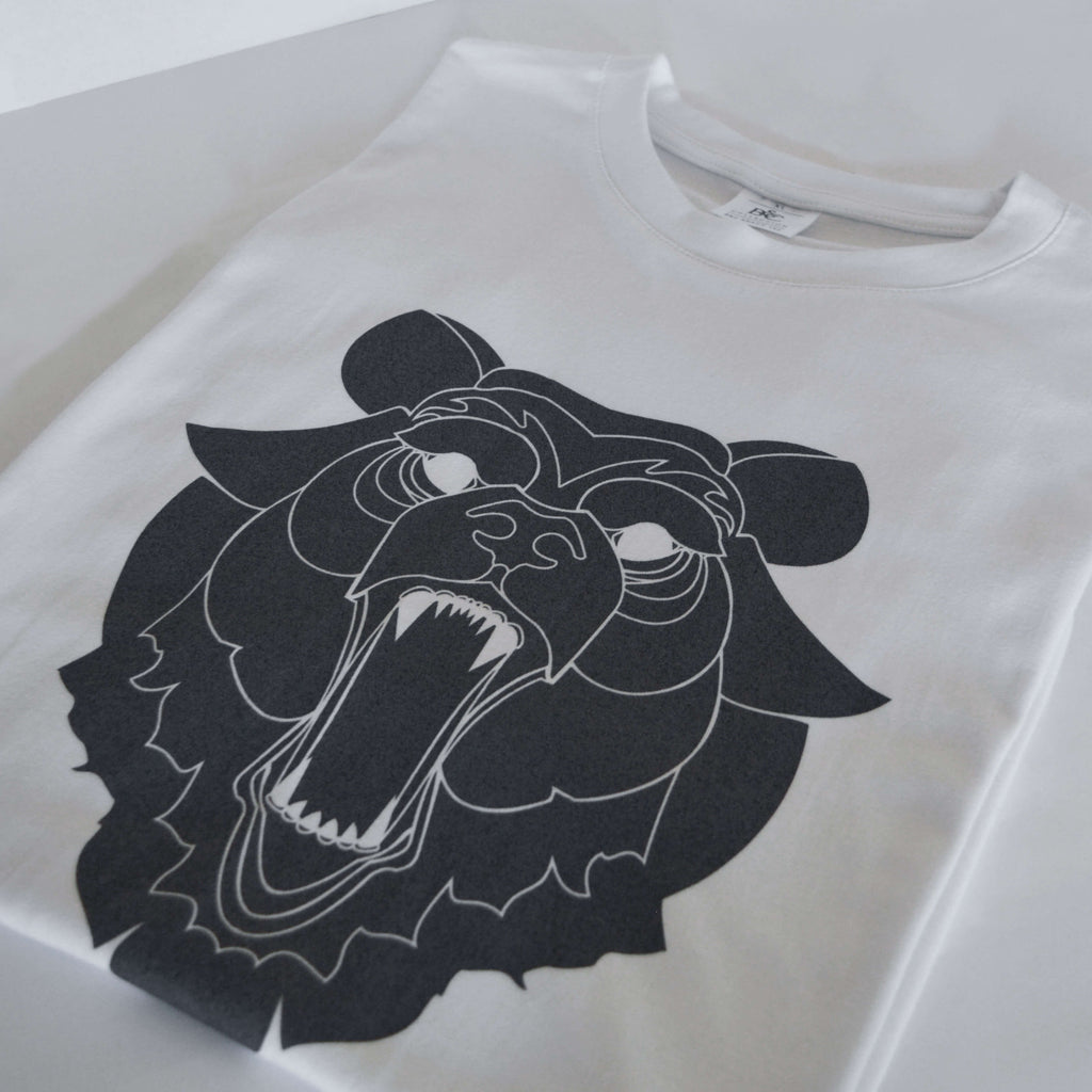 Studio photography showing a grizzly bear t-shirt design.