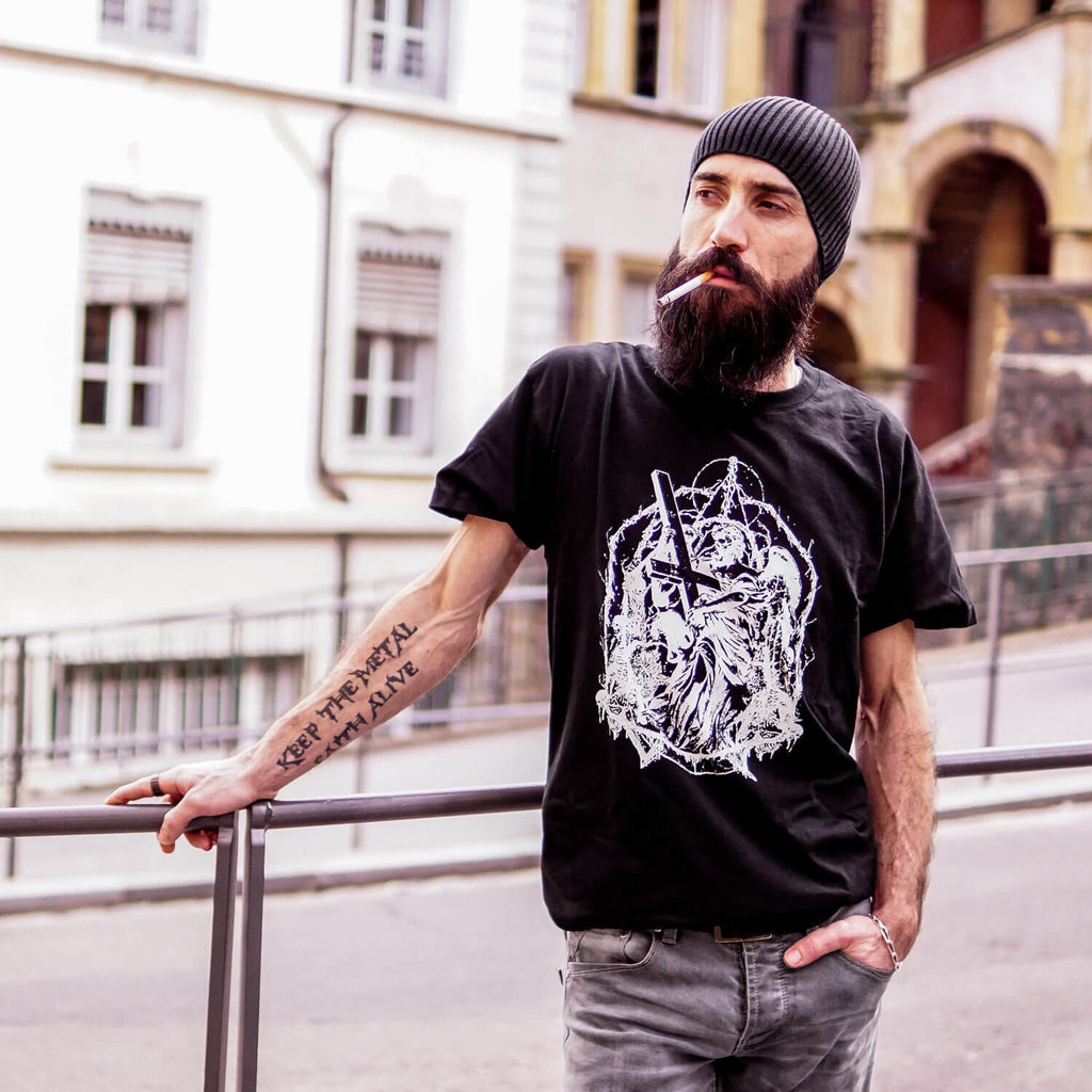 Manu Da Silva, lead guitarist from THE OATH wearing a black t-shirt with a death metal angel design.