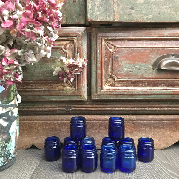 Collection of 12 Vintage Cobalt Blue Glass Vicks Jars