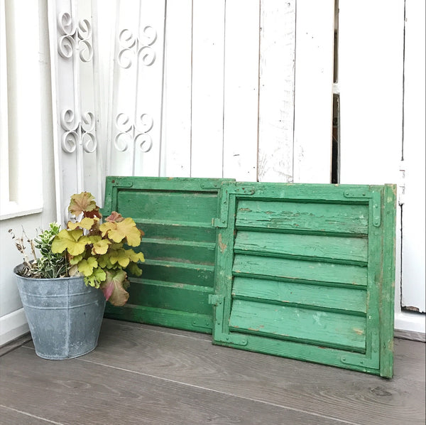 Pair of small reclaimed green shutters