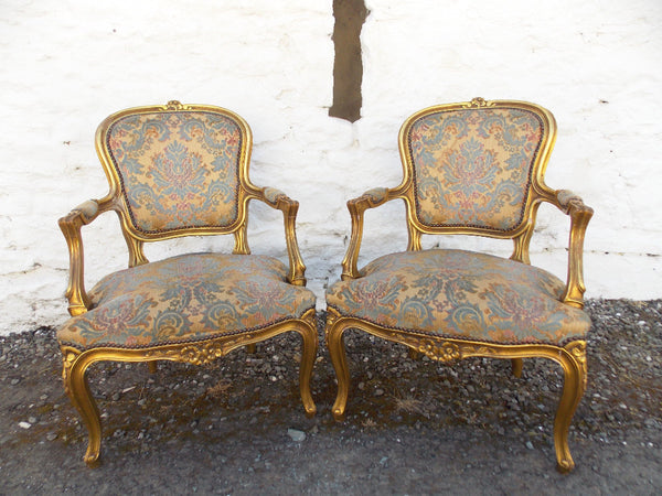 A good pair of 19th cent gilt French Fauteuils. COUNTRY HOMES ANTIQUES