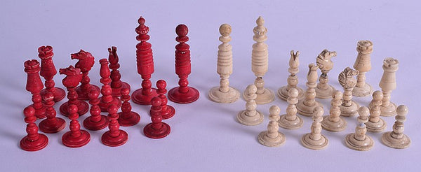 AN EARLY 19TH CENTURY CARVED AND STAINED BONE CHESS SET. COUNTRY HOMES ANTIQUES SCOTLAND
