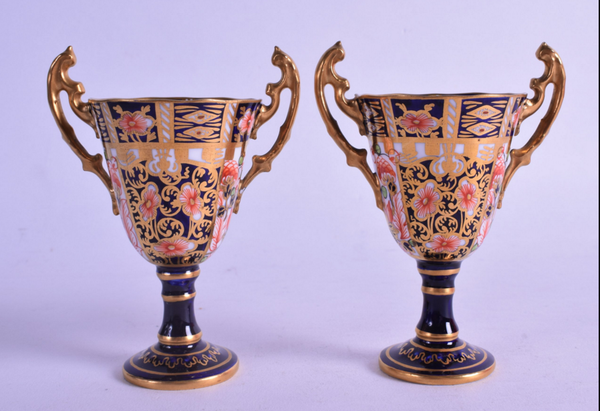 A PAIR OF ROYAL CROWN DERBY TROPHY SHAPED VASES