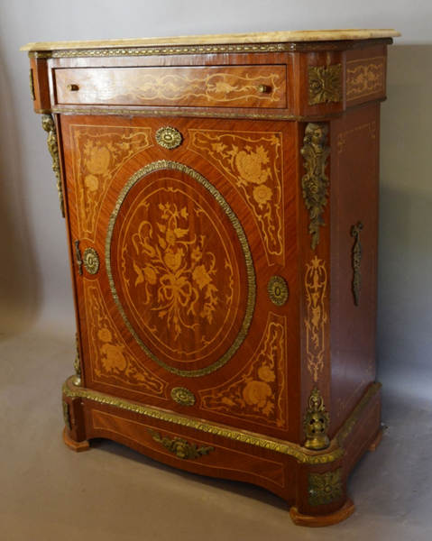 A French Kingwood Marquetry and Ormolu Mounted Pier Cabinet
