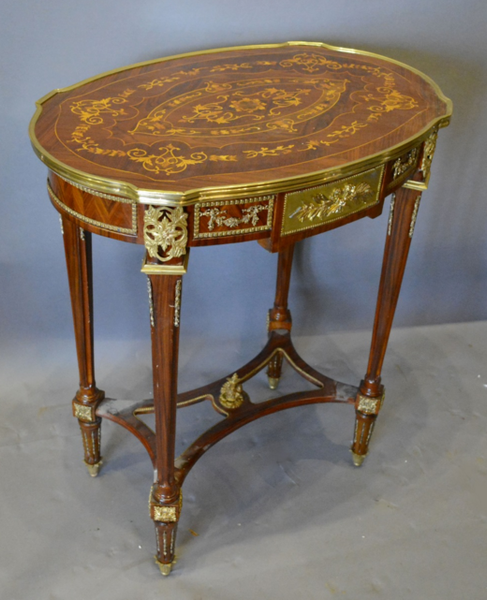 A French Marquetry Inlaid and Gilt Metal Mounted Occasional Table,