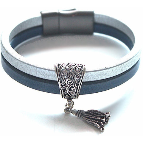 Silver and navy bands of leather with a silver tassel and magnetic clasp.