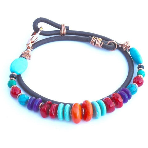 Turquoise, orange, purple,coral stones on a leather wrap bracelet