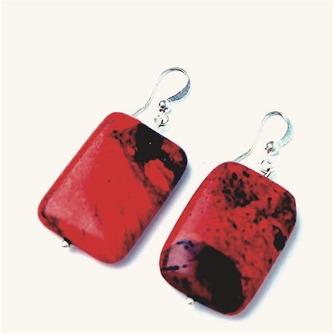 Red rectangle earrings.